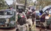 снимка, 'They are sending a clear message... that THEY rule Mexico': Terrifying footage shows CONVOY of Jalisco drug cartel 'soldiers' waving military-grade weapons next to armored trucks and shouting the name of their leader 'Mencho'