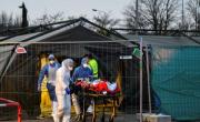 снимка, France steps up coronavirus evacuations from packed hospitals
